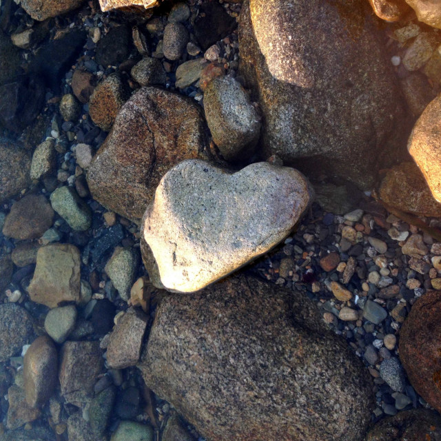 """""""Heart Shaped Rock on the Beach at Sunset"""" stock image"""