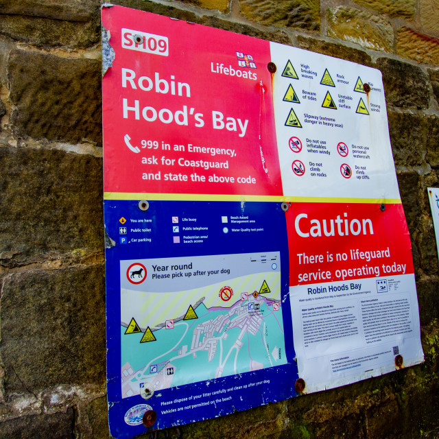 """Robin Hoods Bay, Yorkshire. R.N.L.I. about sign."" stock image"