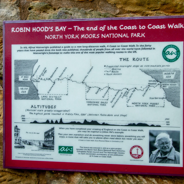 """Robin Hoods Bay, The Dock, Yorkshire England. Coast to Coast information board."" stock image"