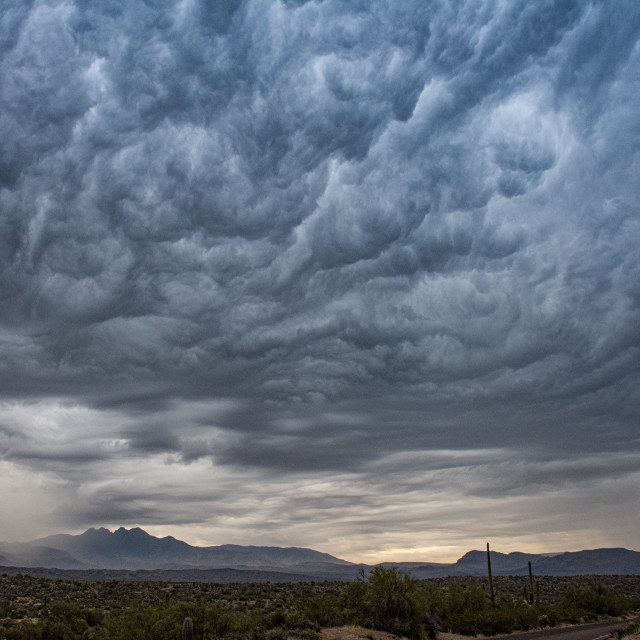 """""""Four Peaks under Monsoon Clouds"""" stock image"""