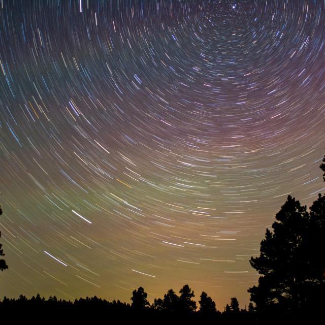 """""""Sky glow star trails"""" stock image"""