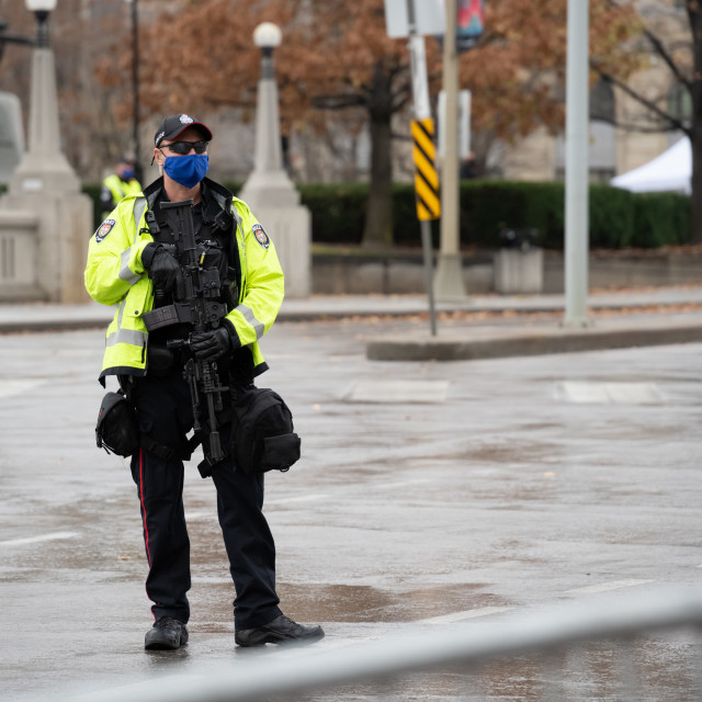 """Policeman Keeps Spectators Away From Remembrance Day Ceremony in Ottawa, Canada."" stock image"