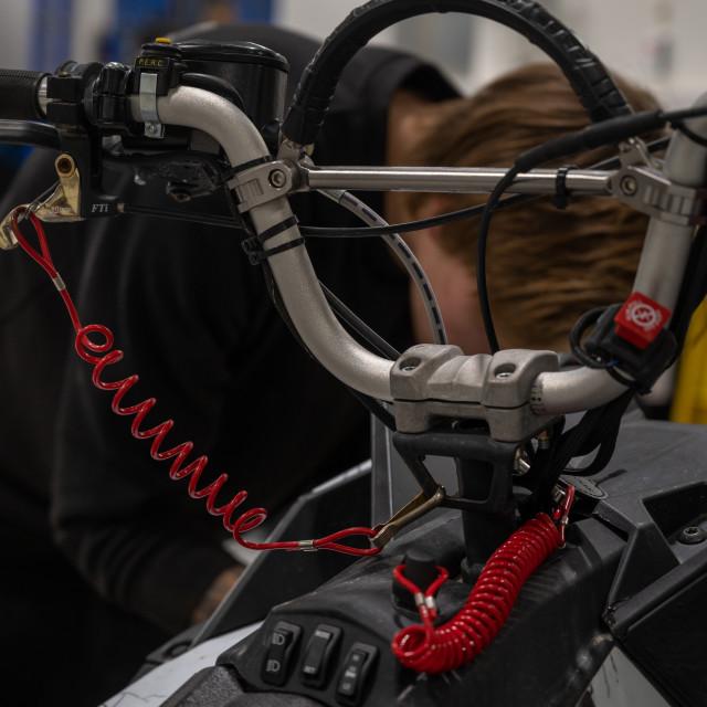 """Mechanic repairing snowmobile"" stock image"