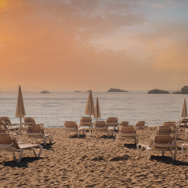 """""""Parasols and deckchairs on beach during sunset. Ibiza"""" stock image"""
