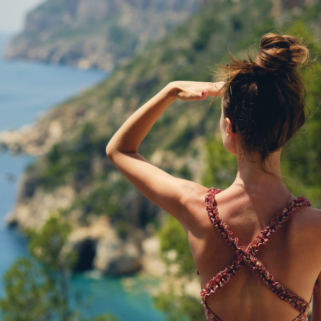 """""""Rear view woman traveller looking into distance enjoy Costa Blan"""" stock image"""