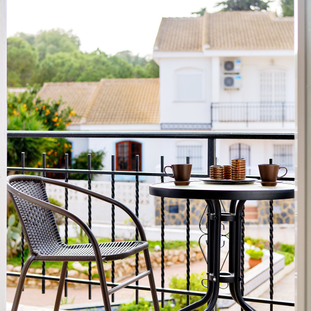 """""""Cozy home terrace with table and chair"""" stock image"""