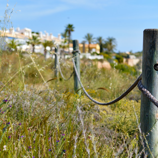 """""""Wooden fencing with rope along the pathway"""" stock image"""