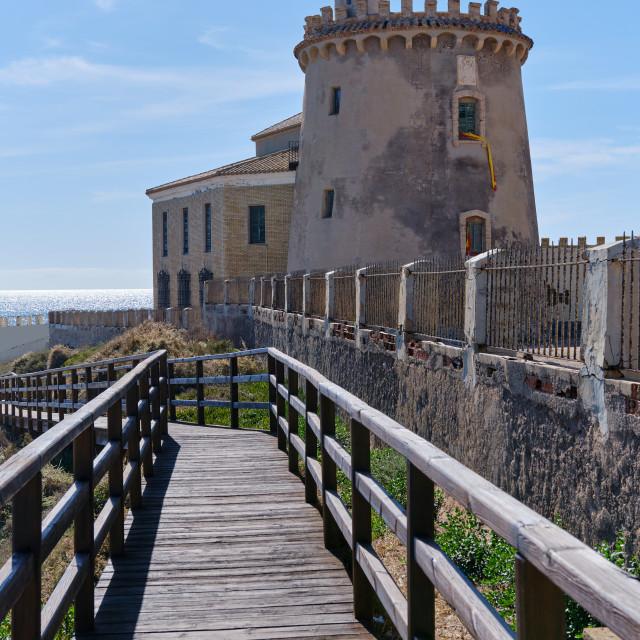 """Fenced wooden bridge leading to watchtower. Pilar de la Horadada"" stock image"