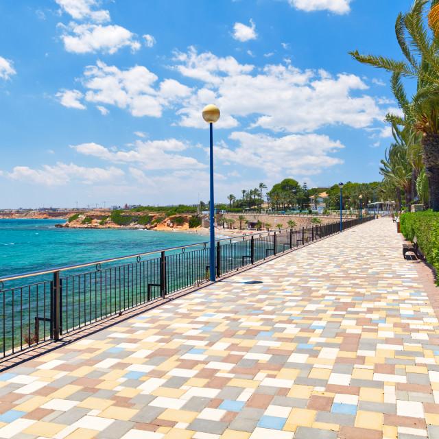 """""""Picturesque seafront promenade of Punta Prima. Spain"""" stock image"""