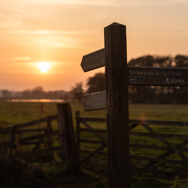 """Fingerpost footpath sign at sunset, Buckenham Marshes."" stock image"