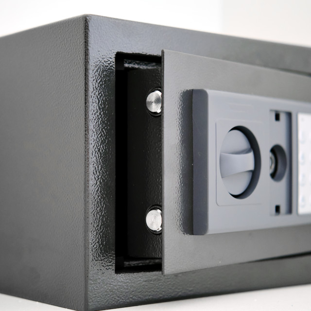 """""""Built into the wall safe with opened door close up view"""" stock image"""