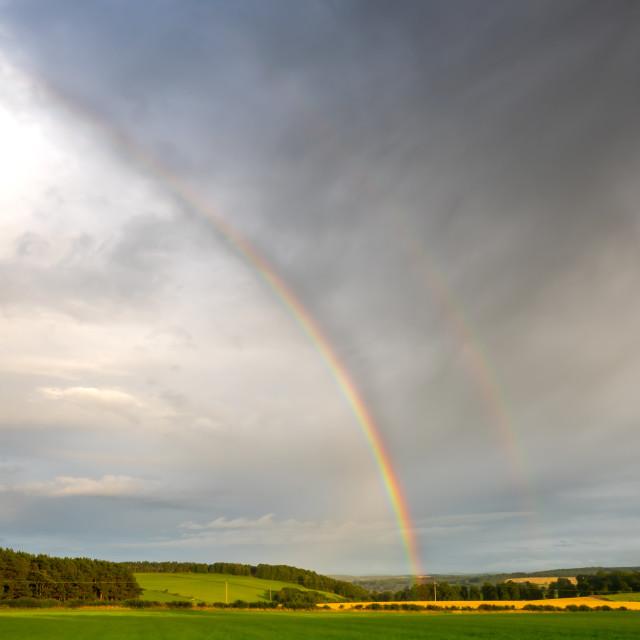 """An Early Autumn Rainbow in Heavy Skys"" stock image"