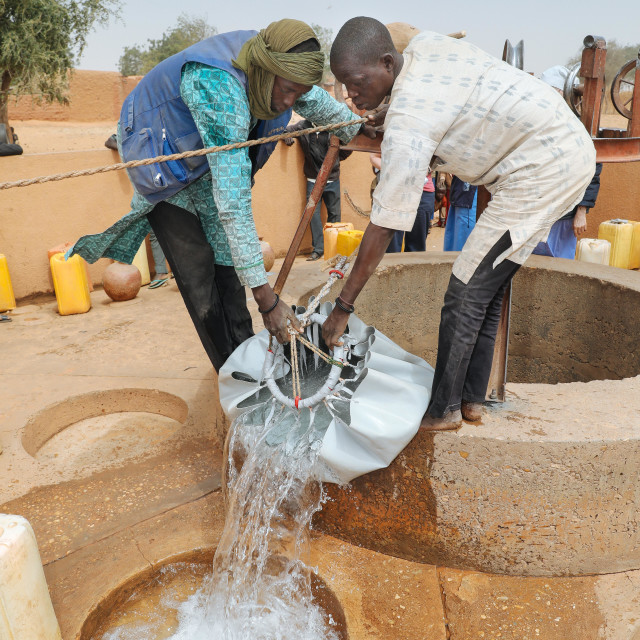 """Deep Well Water Point for Villagers - Tiefbrunnen im Sahel Dorf"" stock image"