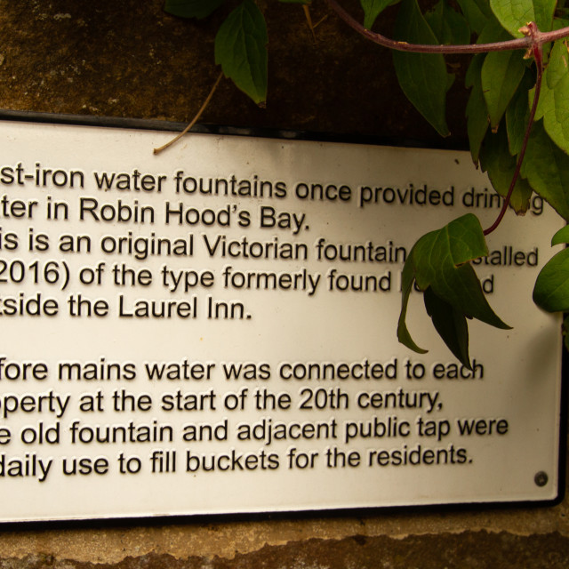 """""""Information Plaque, Cast Iron Water Fountain, Robin Hoods Bay, Yorkshire."""" stock image"""