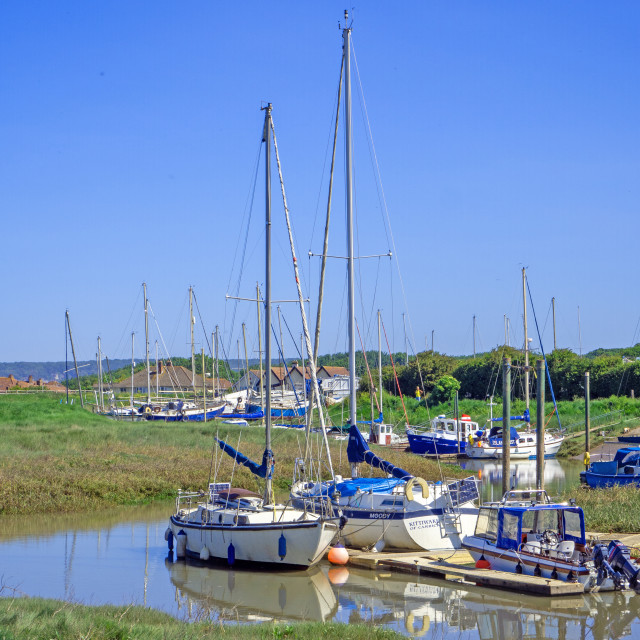"""""""Boats at high tide in Uphill Boatyard Somerset"""" stock image"""