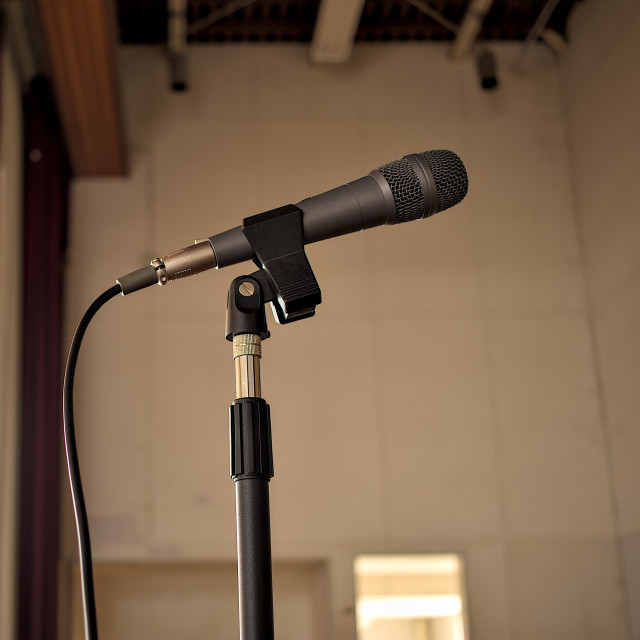 """A gray microphone on a mic stand."" stock image"