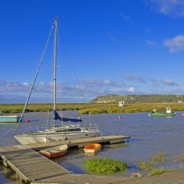 """""""Boats at high tide on the Axe Estuary"""" stock image"""
