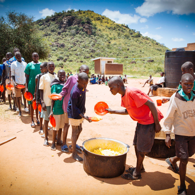 """School lunch in a village school in the rural village of Kotido"" stock image"