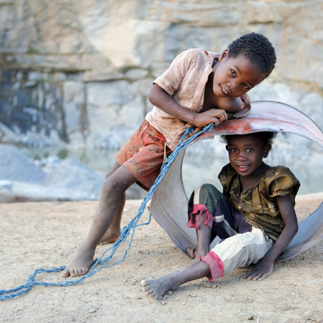 """""""Children playing in a quarry after work"""" stock image"""