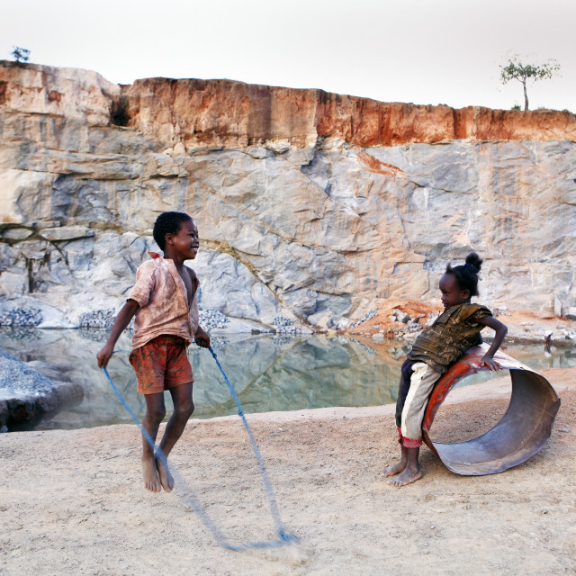 """Children playing in a quarry after work"" stock image"
