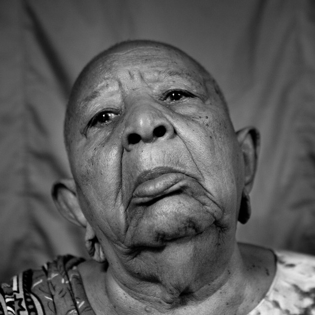 """""""Portrait of a senior woman with shaved head and enlarged earlobes, Lamu..."""" stock image"""