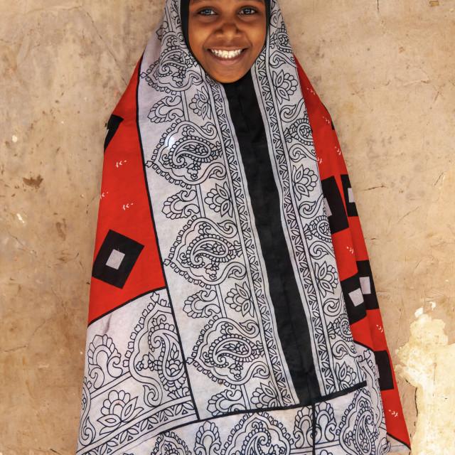 """Portrait of a smiling swahili girl, Lamu County, Siyu, Kenya"" stock image"