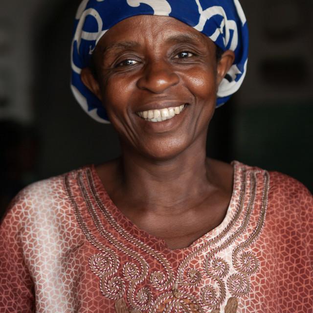 """Portrait of a smiling woman with colorful clothing, Lamu County, Siyu, Kenya"" stock image"