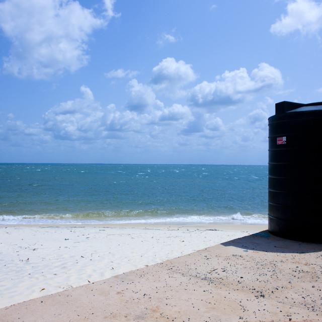 """Black watertank near the beach, Lamu County, Pate Island, Kenya"" stock image"