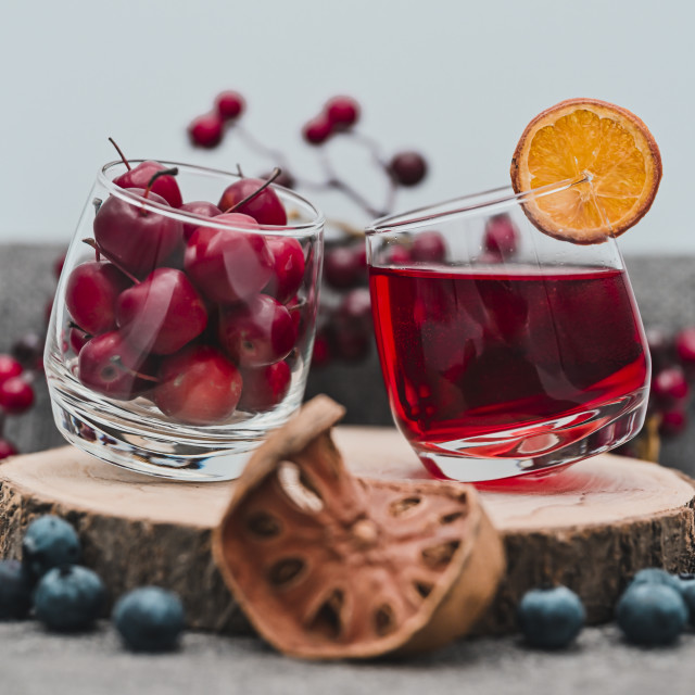 """""""Cherries, blueberries and an orange drink"""" stock image"""