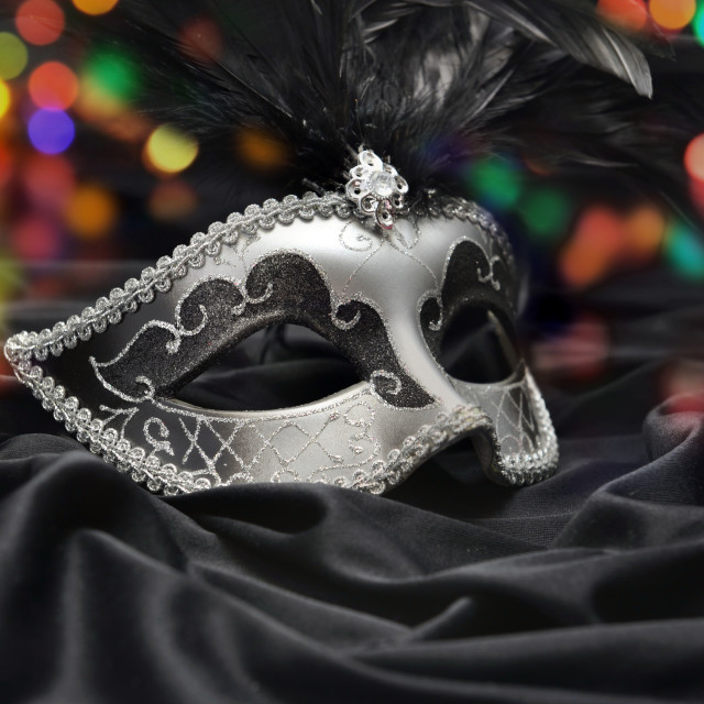 """""""beautiful venitian carnival mask on dark fabric and colorful lig"""" stock image"""