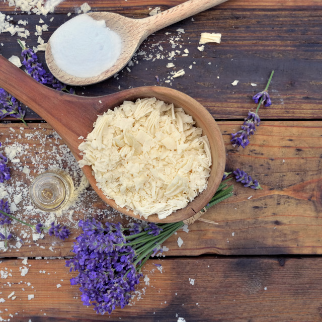 """""""spoon full of flakes of soap with essential oil and bunch of lavender flowers"""" stock image"""