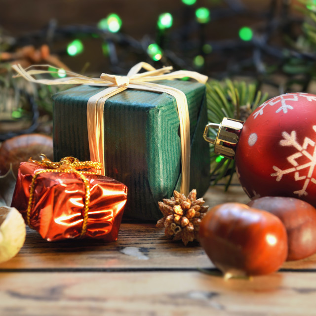 """""""traditional christmas decoration on wooden table with little gift box on blur lights"""" stock image"""