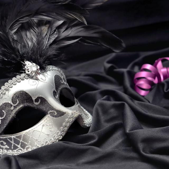 """""""carnival mask on dark satin fabric background with a candle and"""" stock image"""