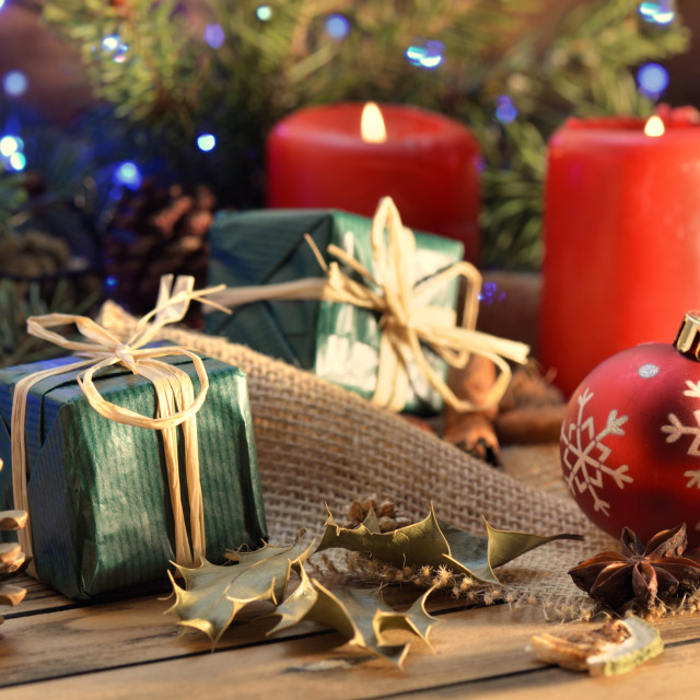 """""""traditional christmas decoration on wooden table with candles and gift box and lights"""" stock image"""