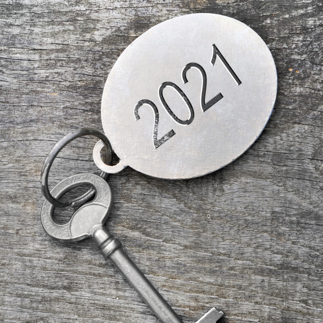 """""""2021 engraved on a ring of an old key on white background"""" stock image"""