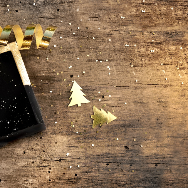 """""""little board on rustic wooden background with golden confetti and ribbon"""" stock image"""
