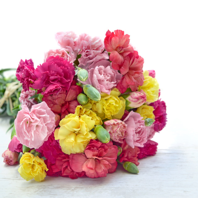 """""""beautiful bouquet of colorful flowers carnation on a white table"""" stock image"""