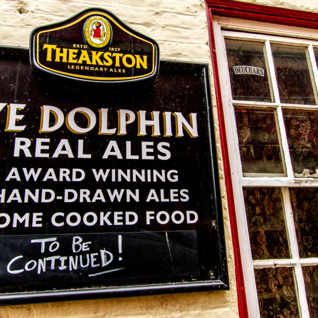 """""""Pub Sign, Ye Dolphin is an unspoilt traditional village pub in the seaside village of Robin Hood's Bay near Whitby on the North Yorkshire coast."""" stock image"""