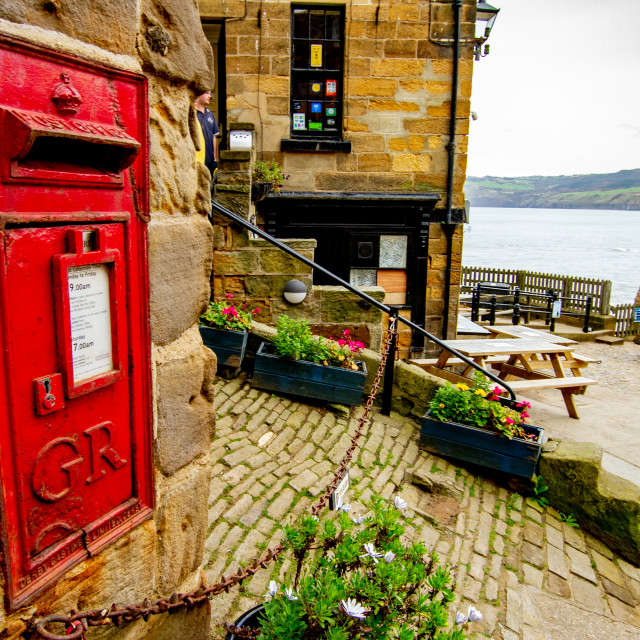"""Red British King George post letter box at The Dock, King Street, Robin Hoods Bay, Yorkshire, England."" stock image"