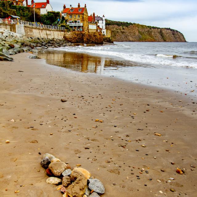 """Robin Hoods Bay, Sea Defences and Beach."" stock image"