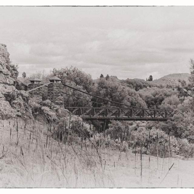 """Historic suspension bridge near Ophir New Zealand"" stock image"