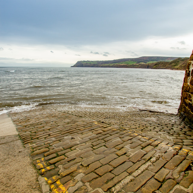 """""""Robin Hoods Bay, Shimmering Sea and Bay View from The Slipway Landing"""" stock image"""