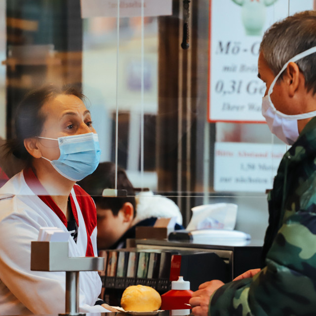 """""""Shopping with face masks during the Corona Pandemic and Crisis"""" stock image"""