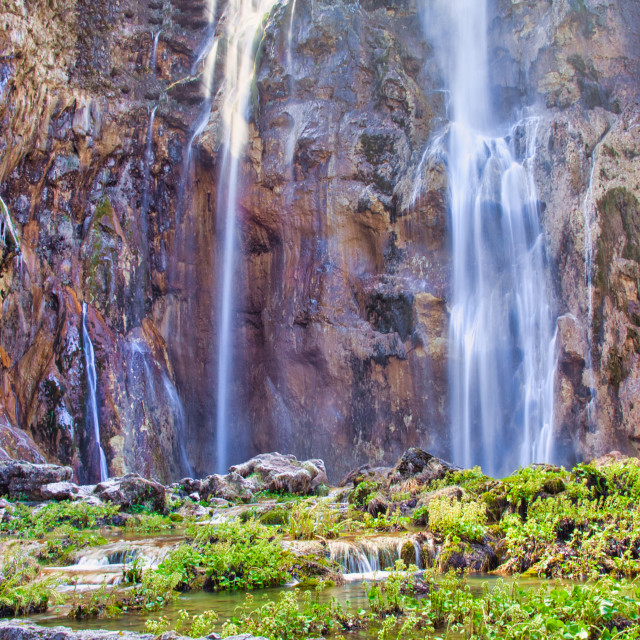 """""""Large Rock Formation With Water Flowing Down at Plitvice Lakes National Park"""" stock image"""