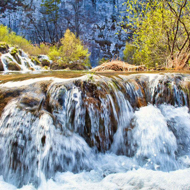 """""""Water Falling Off a Large Flat Rock Formation"""" stock image"""