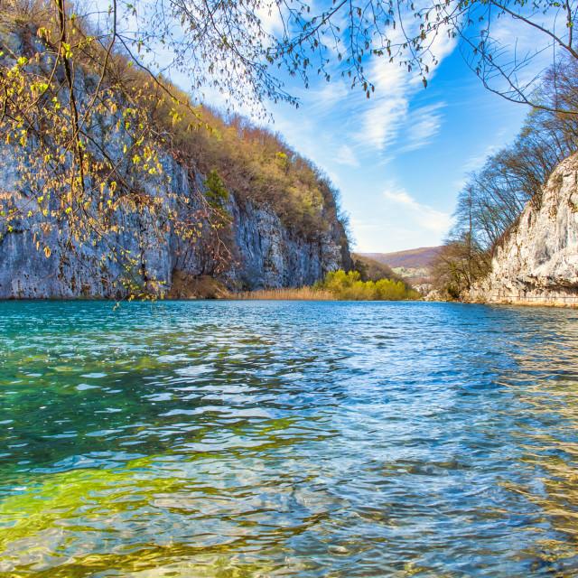 """Plitvice Lake Flowing Toward Large Rock Formations"" stock image"