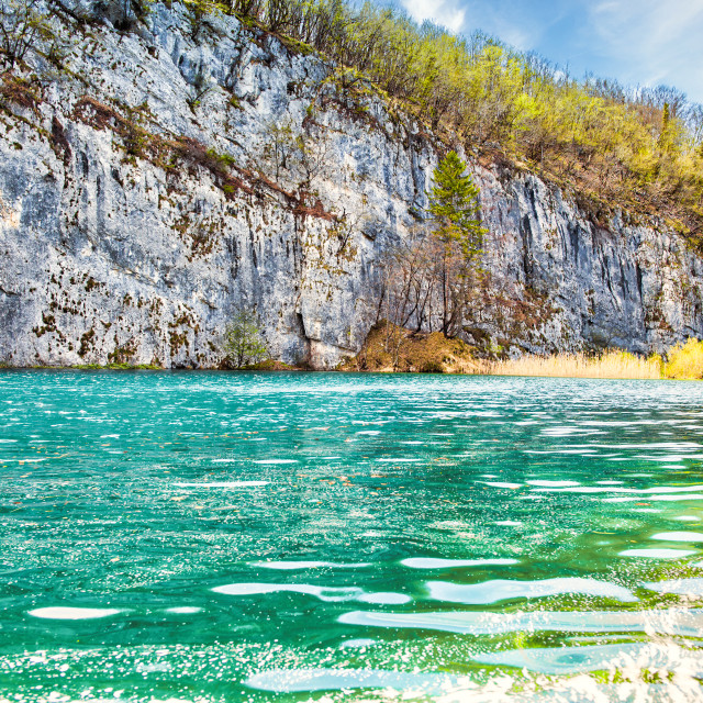 """""""Large Rock Formation with Plitvice Lakes in the Foreground"""" stock image"""