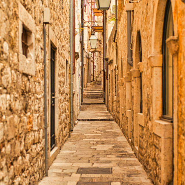 """""""Narrow Stone Pathway in the Old City of Dubrovnik"""" stock image"""