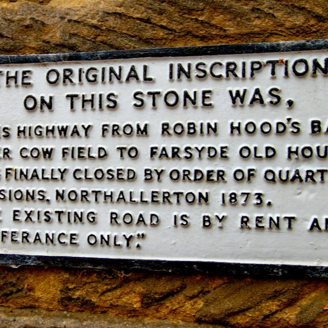 """Replica Inscription Plaque on Stone Wall, Robin Hoods Bay, Yorkshire, UK"" stock image"