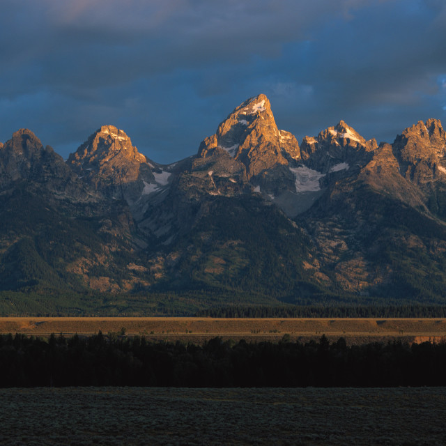 """""""First Light on the Tetons"""" stock image"""